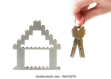keys with house on background.