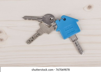 Keys with house shaped blue keyring