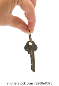 keys with key ring in hand. Isolated on white background.