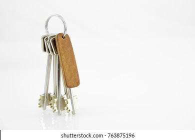 Keys with leather tag isolated on white.
