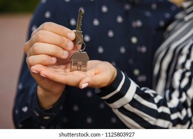 Keys to new home. Couple holding house key