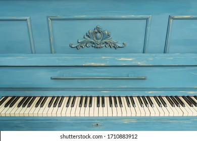 Keys of an old piano. Details of the design of the recolored blue and gold piano. Stucco on the piano