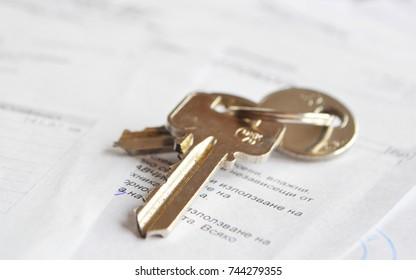 Keys on pile of documents/ Property purchase/ Property Insurance