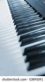 Keys of the piano. A photo close up. Blue tone.