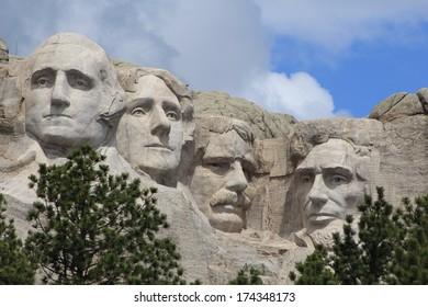 KEYSTONE, SOUTH DAKOTA/U.S.A.-JUNE 21, 2011: Mount Rushmore's granite sculpture of four American Presidents. Presidents at Mount Rushmore are Washington, Jefferson, Roosevelt, and Lincoln.