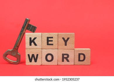 Keyword wooden block word with red background. keyword research concept