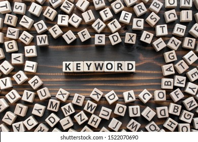 Keyword - word from wooden blocks with letters, search information that contains that word keyword concept, random letters around, top view on wooden background