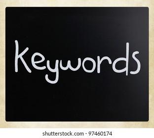 """Keywords"" handwritten with white chalk on a blackboard"