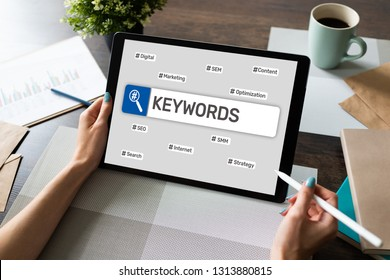Keywords. SEO, Search engine optimization and internet marketing concept on screen.