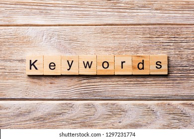 KEYWORDS word written on wood block. KEYWORDS text on wooden table for your desing, concept.