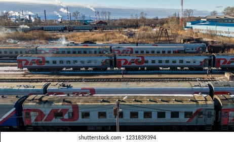 KHABAROVSK, November. 15, 2018: view of the cars of railway passenger cars at the railway depot . Passenger trains, wagons in the depot. passenger trains of Russian Railways. The logo of Russian