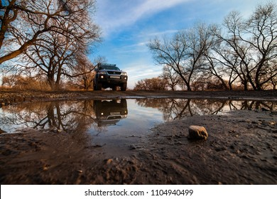 KHABAROVSK, RUSSIA - APRIL 13, 2017: Mitsubishi Pajero Sport on wet dirty road
