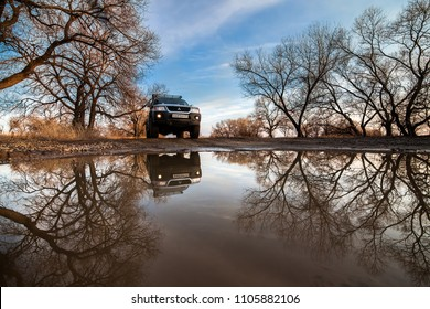 KHABAROVSK, RUSSIA - APRIL 13, 2017: Mitsubishi Pajero Sport at a big puddle