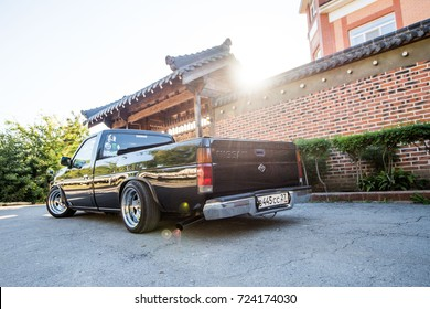 Khabarovsk, Russia - August 28, 2016 :   Nissan Datsun pickup truck on the street, around the house that is in Japanese style