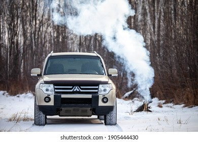 Khabarovsk, Russia - January 7, 2021: Mitsubishi Pajero-Montero in winter forest near bonfire