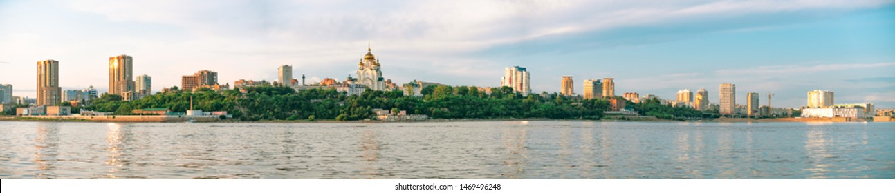 Khabarovsk, Russia - Jul 19, 2019: View of the city of Khabarovsk from the Amur river. Urban landscape in the evening at sunset.