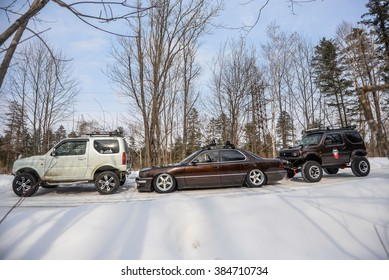 Khabarovsk, Russia - March 2, 2016 : Toyota Lexus is brown and Suzuki Jimny is brown in the winter on the road in the woods