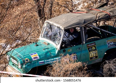 Khabarovsk, Russia - Nov 11, 2019: Jeep UAZ overcomes obstacles in the forest.