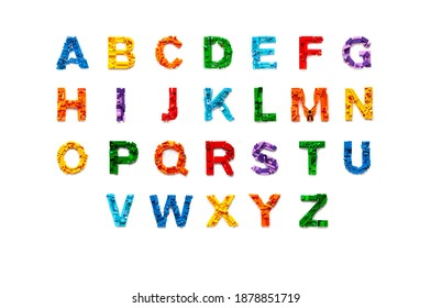 Khabarovsk, Russia, November 17, 2020. Flat lay colourful abc alphabet letters made from the construction blocks of the Lego constructor on white isolated background. Letter mosaic with lego brick.