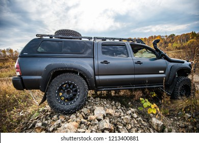 KHABAROVSK, RUSSIA - october 7, 2018: Toyota Tacoma quick ride on a offroad stylish tuning