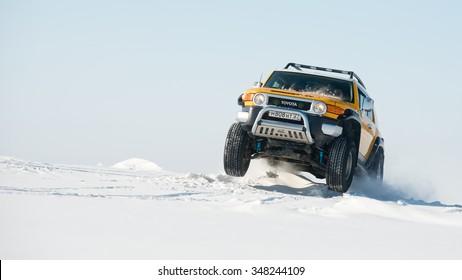 Khabarovsk, Russia - October 9, 2013: Toyota FJ cruiser goes fast on a snowy field