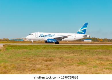 KHABAROVSK, RUSSIA - SEP 29, 2018: Aircraft Sukhoi Superjet 100 RA-89038 Yakutia airline lands at the airport of Khabarovsk.