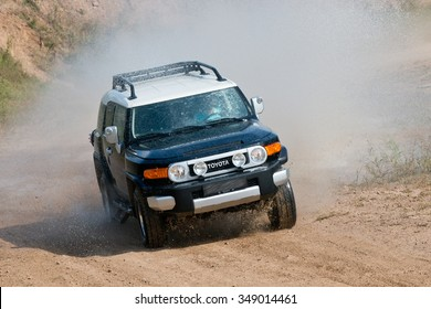KHABAROVSK, RUSSIA - September 10, 2013: Black Toyota FJ cruiser quick ride on a gravel road