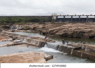Khadakwasla Dam, Maharashtra / India - September 2016: The Khadakwasla Dam is a dam on the Mutha River 21 km from the centre of the city of Pune. The dam created a reservoir known as Khadakwasla Lake.