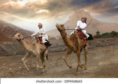 khadal, Oman, 7th April, 2018: men racing camels on a countryside dusty road