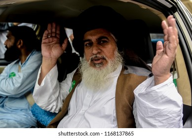 Khadim Hussain Rizvi, head of religous political party Tehreek Labaik Ya Rasool Allah, speaks to supporters during a protest against the Dutch politician Geert Wilders in Lahore, 29 August 2018.