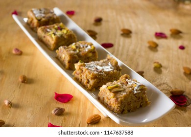 Khajoor ki mithai is one of the tempting and delicious barfi. Nutritious yet mouth watering barfi with good source of iron.