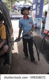 Khajuraho / India 25 February 2017 A man fills a vehicle with petrol at a fuel station at khajuraho madhya pradesh India