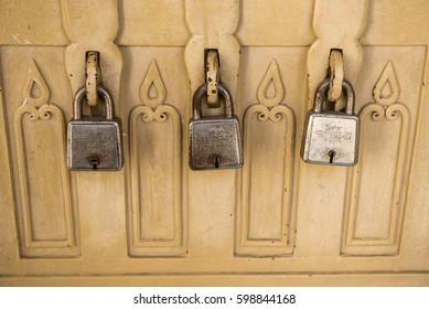 Khajuraho / India 25 February 2017 Three antique lock  old brass padlock On The Old Vintage box at khajuraho madhya pradesh India