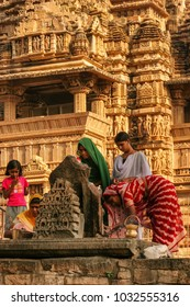 Khajuraho, Madhya Pradesh, India - November 7, 2007 : Indian woman performs morning pooja on temple in Khajuraho, Madhya Pradesh, India.