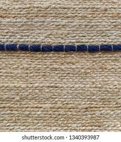 khaki weave burlap texture background with dark blue cotton rope decoration