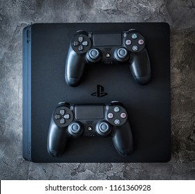 Khakiv, Ukraine - 02 May 2018: Top view of Sony Playstation 4 system with controllers on grey background. Home video game console