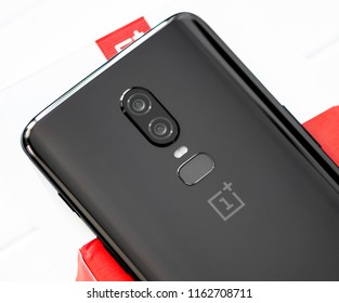 Khakiv, Ukraine - 14 August 2018: Smartphone OnePlus 6 on the white and red box and wooden table