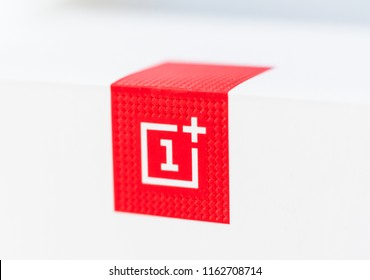 Khakiv, Ukraine - 14 August 2018: Red square logotype of smartphone OnePlus 6 with white background