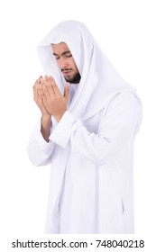Khaliji man supplicates the  Almighty God. isolated on white background.