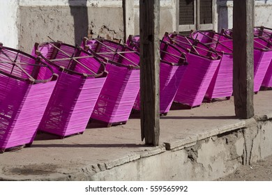 KHAMBHAT, GUJARAT / INDIA - JANUARY 11, 2017 : ROW OF WHEELS, EACH WHEEL IS WRAPED WITH RAW COLOR STRINGS TO DRY UNDER THE SUNLIGHT TO USE ON THE DAY OF KITE FESTIVAL IN INDIA.