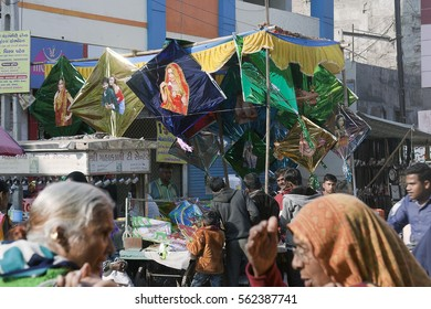 KHAMBHAT, GUJARAT / INDIA - JANUARY 11, 2017 : BIG COLORFUL PLASTIC KITES ARE HUNG OVER THE STALL ON THE STREETS OF KHAMBHAT FOR SALE, BEFORE THE KITE FESTIVAL DAY IN KHAMBHAT, INDIA.