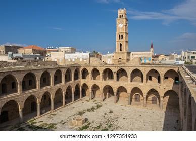 Khan al-Umdan caravanserai with ottoman clock tower in Acre, Israel