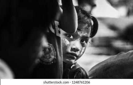 Khanchanaburi Province, Thailand. December2,2018: Little Poor Girl Peeking At Me, At Thai-Myanmar Border Crossing, Sangkraburi District.