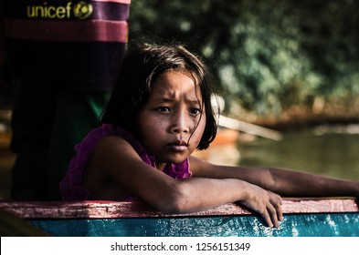 Khanchanaburi Province,Thailand.November23,2018: Little Tour Guide Girl Waiting For Tourist Group, At Wat Som Det Temple, Sangkraburi District.