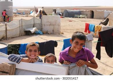 KHANKE REFUGEE CAMP, DOHUK, KURDISTAN, IRAQ - 2015 JULY 30 - Unidentified refugees smiling in Khanke (khanke) camp near Dohuk in Northern Iraq