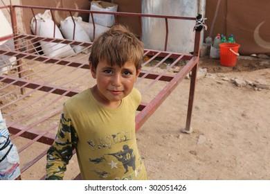 KHANKE REFUGEE CAMP, DOHUK, KURDISTAN, IRAQ - 2015 JULY 30 - Unidentified refugee boy in Khanke (khanke) camp near Dohuk in Northern Iraq
