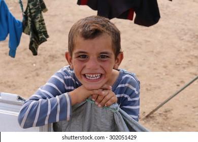 KHANKE REFUGEE CAMP, DOHUK, KURDISTAN, IRAQ - 2015 JULY 30 - Unidentified refugee smiling in Khanke (khanke) camp near Dohuk in Northern Iraq