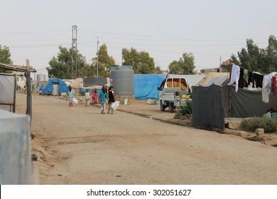 KHANKE REFUGEE CAMP, DOHUK, KURDISTAN, IRAQ - 2015 JULY 30 - A dirt road in Khanke (khanke) camp near Dohuk in Northern Iraq