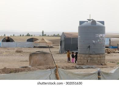 KHANKE REFUGEE CAMP, DOHUK, KURDISTAN, IRAQ - 2015 JULY 30 - A water tank in Khanke (khanke) camp near Dohuk in Northern Iraq