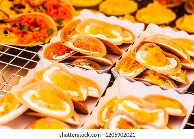 Khanom Buang. Crepes that look like tacos and are a popular street food in Thailand. They are normally stuffed with cream along with other sweet or savoury toppings.